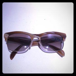 5a0b0846c5 Prada. Prada SPR 11P Sunglasses.  180  400